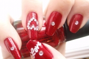 general-sweet-loveable-fresh-red-with-white-love-text-and-3d-heart-decoration-nail-design-for-valentine-new-nails-designs-2012